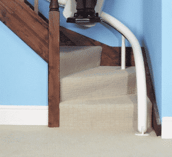 A drop nose stairlift rail