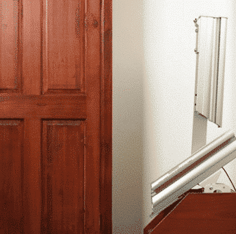 a hinged track stairlift in a home