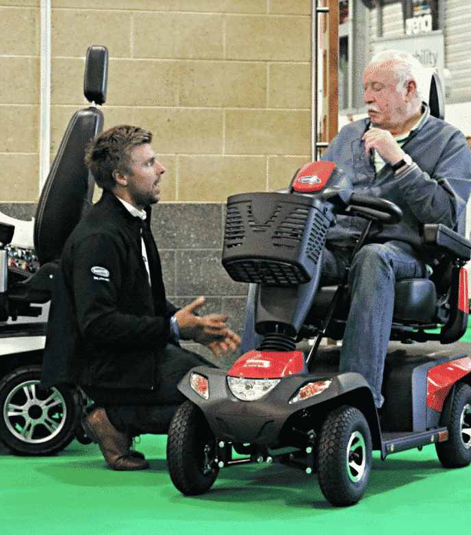 Ben Upson talking to a visitor at The Motability One Big Day Event