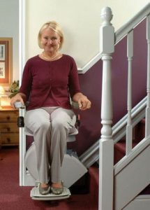 Woman sitting on Stairlifts