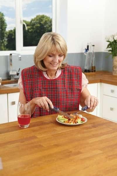 A woman wearing a washable dinner bib