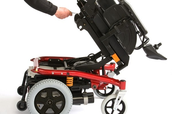 A Spectra XTR 2 mobility powerchair being folded down for servicing and storage