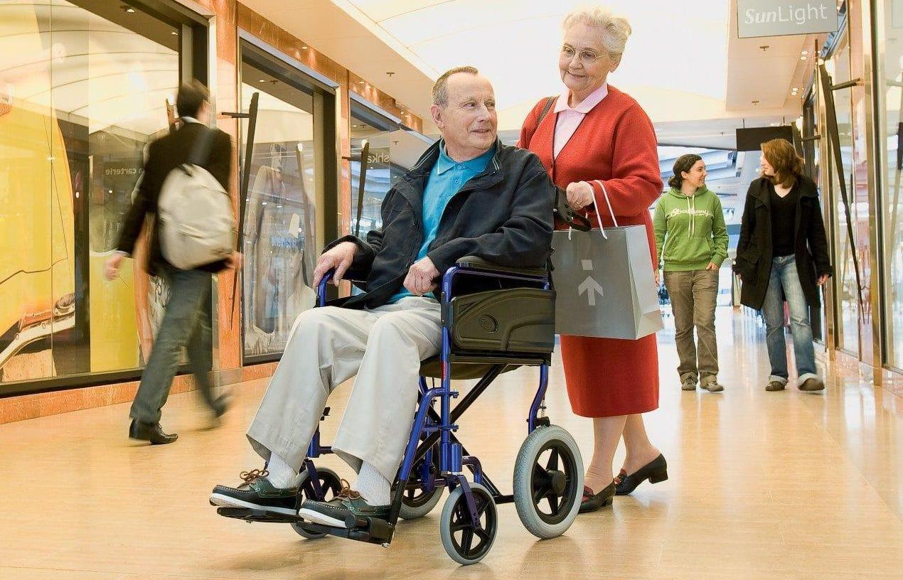 Manual wheelchair in shopping precinct