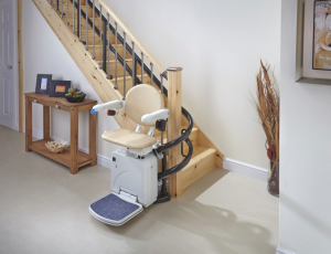 Handicare 2000 curved stairlift at the bottom of the stairs
