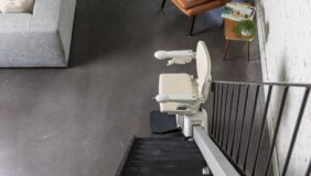 Handicare 1100 Stairlift at the bottom of the stairs