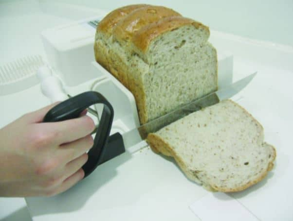 Cutting bread on a food workstation